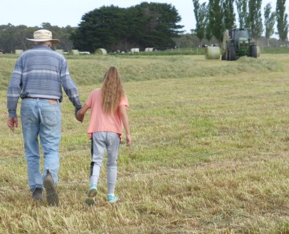 Heading off to the tractor for a bit of harvest