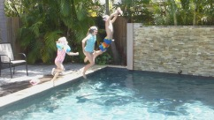 Teaching Kate to jump in the pool